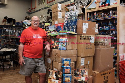 082616  Wesley Bunnell | Staff  Steve Amato, owner Amato's Toy & Hobby,  is traveling to Louisiana with his wife over Labor Day weekend to distribute about five thousand toys to children devastated by the recent flooding.  Steve is shown with some of the many boxes of toys in his New Britain store on Friday afternoon.