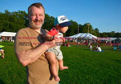 8/26/2016 Mike Orazzi | Staff Frank Nissen and his son Seth, 6 months, listen to music during the annual Plainville Balloon Festival.