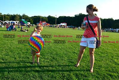 8/26/2016 Mike Orazzi | Staff AJ Nassar and his mom Dawn during the annual Plainville Balloon Festival.