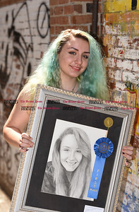 082616  Wesley Bunnell | Staff  Local artist Tiana Mandell was photographed on Friday Aug 26 with her award winning drawing which was exhibited this past spring at the New Britain Museum of American Art.