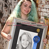 082616  Wesley Bunnell | Staff<br /> <br /> Local artist Tiana Mandell was photographed on Friday Aug 26 with her award winning drawing which was exhibited this past spring at the New Britain Museum of American Art.