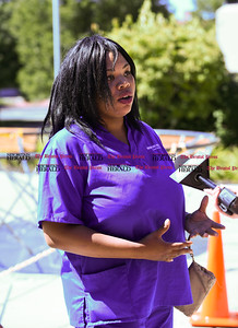 082916  Wesley Bunnell | Staff  Janice Hall who identified herself as Kunta Kinta Cupa's girlfriend gave an interview outside of New Britain Superior Courthouse on Monday afternoon. Cupa was arraigned before Judge Joan Alexander in the shooting of Angela Semidey on Aug 19.