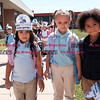 082916  Wesley Bunnell | Staff<br /> <br /> Kindergarten students leave Smith Elementary School ready to board buses for the ride home on Monday afternoon after their first day of school. Students wore hats reading I Rocked My First Day of School.
