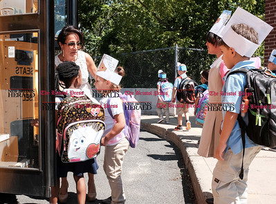 082916  Wesley Bunnell | Staff  Kindergarten students board buses after their first day of school Smith Elementary School on Monday afternoon.