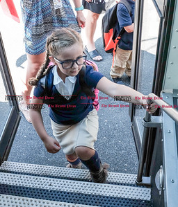 082916  Wesley Bunnell | Staff  Kindergarten students board their buses at Smith Elementary School on Monday afternoon after their first day of school.