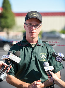 082916  Wesley Bunnell | Staff  Supervisor of Emergency Response with the CT Department of Energy and Environmental Protection Jeff Chandler addresses the media on Monday afternoon with updates from the chemical spill at Light Metals on Aug 24.