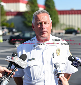 082916  Wesley Bunnell | Staff  Southington Fire Chief Harold Clark addresses the media on Monday afternoon with updates from the chemical spill at Light Metals on Aug 24. Also present was an official from the state Department of Energy and Environmental Protection.