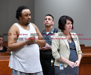 082916  Wesley Bunnell | Staff  Kunta Kinta Cupa, left, of Branford standing next to his attorney was arraigned in New Britain Superior Court before Judge Joan Alexander on Monday afternoon in the shooting of Angela Semidey on Aug 19.