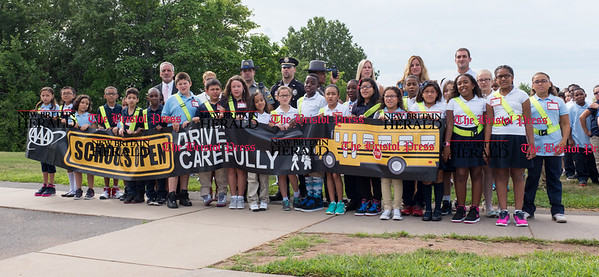 082916  Wesley Bunnell | Staff  5th grade students of Smith School hold a AAA banner after receiving their Safety Patrol sashes in a ceremony on Monday morning. Students received their sashes in the attendance of local school officials , police and a AAA representative.
