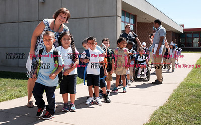 082916  Wesley Bunnell | Staff  Kindergarten students line up outside Smith Elementary School ready to board their buses for the ride home after their first day of school.