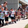 082916  Wesley Bunnell | Staff<br /> <br /> Kindergarten students line up outside Smith Elementary School ready to board their buses for the ride home after their first day of school.