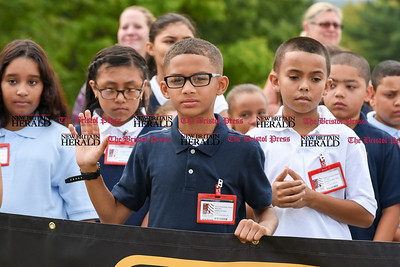 082916  Wesley Bunnell | Staff  Smith School students raise their hands when asked who is participating in the AAA Safety Patrol program. The ceremony was held on Monday with 5th grade students and the attendance of local school officials , police and a AAA representative.