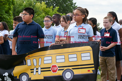 082916  Wesley Bunnell | Staff  Smith School students hold a banner from the AAA promoting school safety. During the ceremony 5th grade students received their Safety Patrol sashes in the attendance of local school officials , police and a AAA representative.
