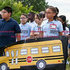 082916  Wesley Bunnell | Staff<br /> <br /> Smith School students hold a banner from the AAA promoting school safety. During the ceremony 5th grade students received their Safety Patrol sashes in the attendance of local school officials , police and a AAA representative.
