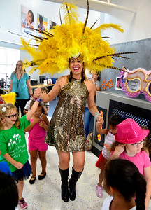 "8/11/2016 Mike Orazzi | Staff Noley Collins dances with children while at the ""Circle of Fun"" event at the Imagine Nation, A Museum Early Learning Center, on Thursday."