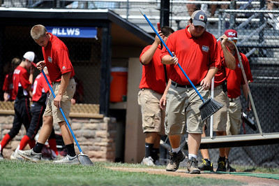 8/11/2016 Mike Orazzi | Staff The grounds crew works on Breen Field during the Eastern Regional Little League Tournament on Thursday.