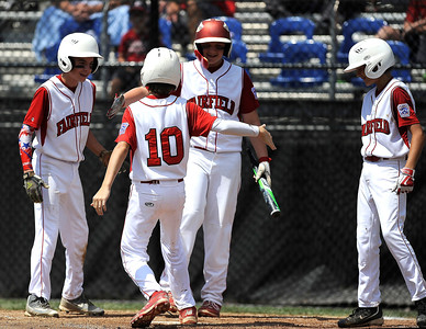 8/11/2016 Mike Orazzi | Staff Fairfield American's Matthew Sawyer (10) rounds the bases after his home run during the Eastern Regional Little League Tournament on Thursday.