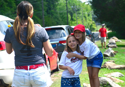 8/11/2016 Mike Orazzi | Staff Michelle Cook photographs her daughters Julia and Claudia while in Bristol for the Eastern Regional Little League Tournament on Thursday. Their cousin Ben Gaffney is a member of the Fairfield American Little League Team.
