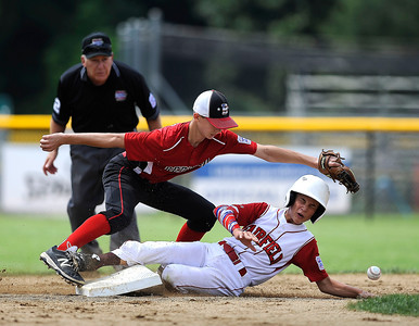 8/11/2016 Mike Orazzi | Staff New Hampshire's Ryan Juliano (3) waits for the ball as Fairfield American's Ryan McIntosh (5) slides into second during the Eastern Regional Little League Tournament on Thursday.
