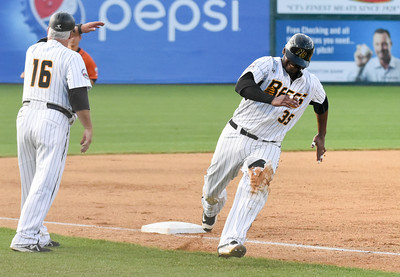 081616  Wesley Bunnell  | Staff  Jovan Rosa #35 rounds 3rd base attempting to score. The New Britain Bees took on the Long Island Ducks in the 2nd game of the series on Tuesday evening.