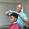 081616  Wesley Bunnell  | Staff<br /> <br /> New owner Heath Long of Modern Barber Shop in Newington works on local 8th grader Diogo Caetano's hair on Tuesday afternoon.