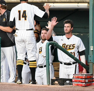 081616  Wesley Bunnell  | Staff  Jon Griffin #33 high fives Michael Crouse #14 as he comes into the dugout after scoring a run. The New Britain Bees took on the Long Island Ducks in the 2nd game of the series on Tuesday evening.