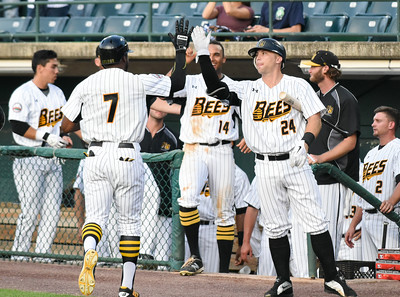 081616  Wesley Bunnell  | Staff  Craig Maddox #24 high gives Greg Golson #7 on his way back to the dugout after hitting a home run. The New Britain Bees took on the Long Island Ducks in the 2nd game of the series on Tuesday evening.