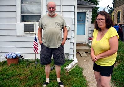 8/17/2016 Mike Orazzi | Staff Vietnam veteran Robert Gentle and his wife Doreen outside theirCyprus Street home in Bristol. A volunteer group is doing some renovations the couple.