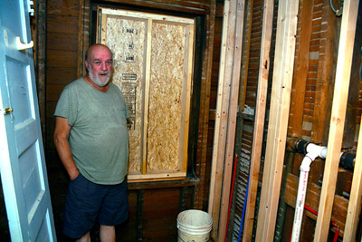 8/17/2016 Mike Orazzi | Staff Vietnam veteran Robert Gentle in the doorway of a second floor bathroom of his Cyprus Street home in Bristol. A volunteer group is doing some renovations for him and his wife Doreen.
