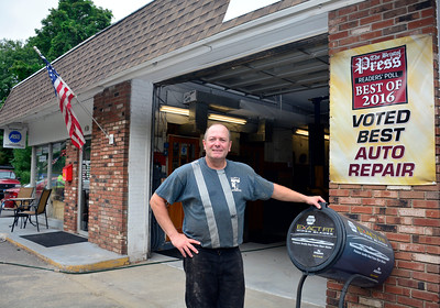 8/17/2016 Mike Orazzi | Staff Cliff Jones at Cliff's Auto in Terryville.