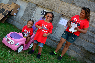 8/20/2016 Mike Orazzi | Staff Claribel Ruiz with her children Analiz and Keidy in downtown New Britain during the Mama Stitches event held at Trinity on Main Saturday.