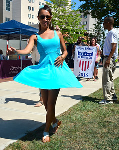8/20/2016 Mike Orazzi | Staff Nicole Graboski dances to the beat during  a mini parade of city officials in downtown New Britain during the Mama Stitches event held at Trinity on Main Saturday.