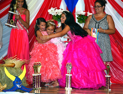 8/20/2016 Mike Orazzi | Staff Natalia Peluso (left) after being crowned 2016 Little Miss Puerto Rico of New Britain during a pageant held at Puerto Rican Society on High Street Saturday.