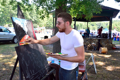 8/20/2016 Mike Orazzi | Staff Artist Chris Brown paints during the Rockwell Park festival on Saturday in Bristol.
