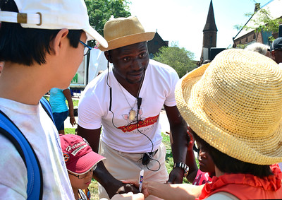 8/20/2016 Mike Orazzi | Staff Mama Stitches author Akintunde Sogunro signs books in downtown New Britain during the Mama Stitches event held at Trinity on Main Saturday.