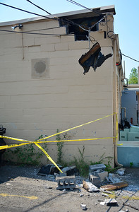 8/24/2016 Mike Orazzi   Staff Overnight damage to a building at 899 Farmington Avenue in Bristol Wednesday. They were unsure of what caused the damage.