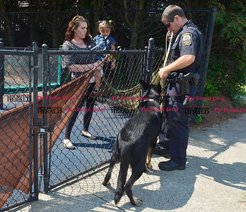 8/24/2016 Mike Orazzi | Staff Bristol Police officer Tim O'Brien and his police dog partner Murphy meet Christa Terranova and Jereyshaliz Rosado as part of the Dog Days of Summer program at the Imagine Nation Museum Early Learning Center Wednesday morning.