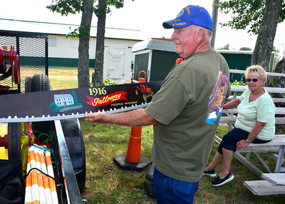 8/25/2016 Mike Orazzi | Staff Fred Messenger shows off a custom painted hand saw of the home he grew up in while setting up his display at the Terryville Fair Thursday. The fair kicks off Friday at 5 pm and runs through Sunday. Off to the right is Fred's wife Zel.