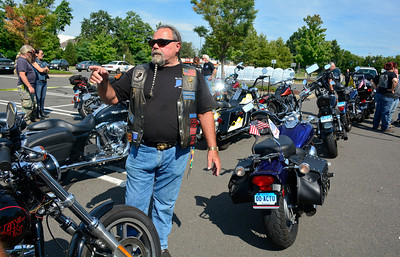 "8/25/2016 Mike Orazzi | Staff John ""Maddog"" Scanlon while gathering with fellow bikers for the Rear Area Support Foundation Inc. (RASF) and the Connecticut Friends of Veterans, Inc. before escorting the Global War on Terror Wall of Remembrance traveling memorial from Southington to West Hartford Thursday morning."