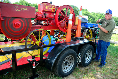 8/25/2016 Mike Orazzi | Staff Fred Messenger sets up a 100 year old Galloway Masterpiece Six saw at his display at the Terryville Fair Thursday. The fair kicks off Friday at 5 pm and runs through Sunday. The saw has been in his family for 100 years and was recently restored.