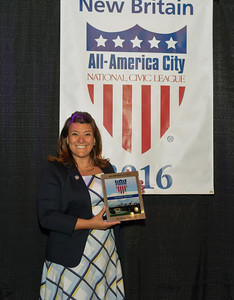 082416  Wesley Bunnell | Staff  Mayor Erin Stewart poses with the official All American City award presented to the City of New Britain. New Britain celebrated its All American City status on Thursday evening at Trinity on Main with a reception.