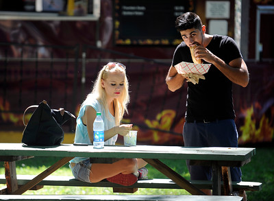 8/27/2016 Mike Orazzi   Staff Vince Lombardi and Agnieszka Lisiecka sample some food during Saturday's Dozynki Festival held at Falcon Field in New Britain.