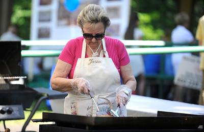 "8/27/2016 Mike Orazzi   Staff Janina ""Jasia"" Radziwon cooks potato pancakes during Saturday's Dozynki Festival held at Falcon Field in New Britain."