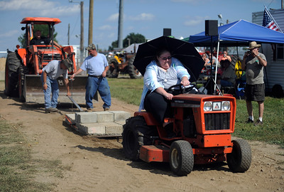 8/27/2016 Mike Orazzi   Staff Victoria Albertson pull 1900 pounds with her garden tractor during the 68th  annual Terryville Lions Country Fair Saturday afternoon.
