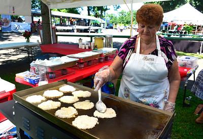 8/27/2016 Mike Orazzi   Staff Roma Kaczynski cooks potato pancakes during Saturday's Dozynki Festival held at Falcon Field in New Britain.