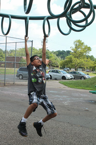 Alexis Ortiz playing on the playground at Chesley Park on Friday afternoon.