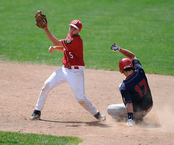 8/5/2016 Mike Orazzi | Staff Bristol American Legion's Richard Lemke (5) as  New Hampshire's Justin Jewell (17) slides into second during the Northeast Regional American Legion Baseball Tournament in Bristol Friday.