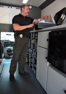 8/5/2016 Mike Orazzi | Staff Bristol Police Detective Scott Hayden inside the city's new crime van Friday.