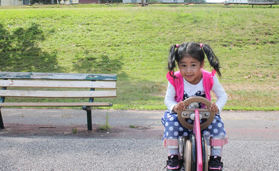 Maria Morales playing on the playground at Chesley Park on Friday afternoon.