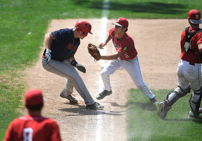 8/5/2016 Mike Orazzi | Staff Bristol American Legion's Cory Fradette (2) runs down New Hampshire's Justin Jewell (17) at third during the Northeast Regional American Legion Baseball Tournament in Bristol Friday.